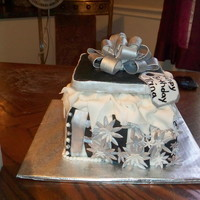 "Black And Silver Birthday Cake 4 8"" square stack cakes top half was vanilla butternut flavored with chocolate buttercream and the bottom 2 layers was coconut cake..."