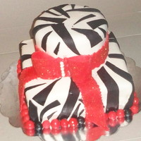 Zebra Print Was asked to do a cake with the color contrast of black and red ,perfect opportunity to try the zebra print..TFL
