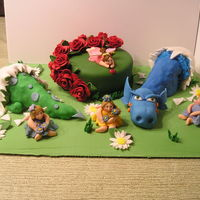 Fairy Garden Dragons My daughters and I created this cake. The round and eggs are cake. The dragons are rice treats and fondant. Everything else is fondant....