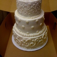 Off White Wedding Cake In Dots And Swirls Dots and swirls was theme for this buttercream wedding cake. The top and bottom tiers were made of white cake, the middle tier was made...