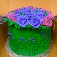 Purple And Green Birthday Cake Made this for a friends birthday. Her favorite colors are purple and green so i came up with this. The vibrant grass border, electric...
