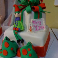 Waiting For Christmas I decorated this in a class I recently took at a nearby bakery. Elf is made of fondant. The vanilla cakes are also covered in fondant. He...