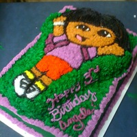 Dora The Explorer Dora made of chocolate cake, plus sheet cake made of vanilla, plus buttercream icing, equals very happy little 3 year old. priceless...
