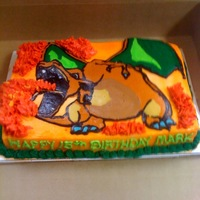Charizard Birthday Cake All butter cream. This is my first transfer cake. I printed a photo, then used butter cream on the reversed image to the 1/4 sheet cake.