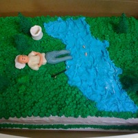 Gone Fishing This was made for an 80 year old man who loved to fish. Grass and river is made with buttercream. The trees and the deer is not edible....