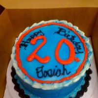 Birthday Cake Red Velvet cake with cream cheese icing. The words are made with buttercream. The Blue was airbrushed.