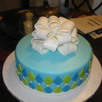 Geometric Designs Cake   my first cake with shape cutter and bow.