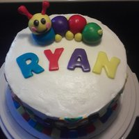 Ryan's 1St Birthday  Chocolate cake torted and filled with bavarian cream, buttercream frosting, and MMF accents and caterpillar. Inspired by many cakes online...