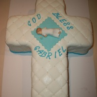 God Bless Gabriel WASC w/raspberry filling, buttercream, and MMF. Fondant baby, pacifier, and blanket. Made for my nephew's baptism.