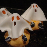Fondant Ghost Cupcakes This Fondant Ghost Cupcake for Halloween is a blast to make. The fondant ghost sheet is draped over a large Toostie roll with a candy...