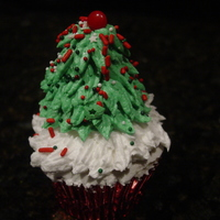 "Figure Piped Christmas Tree! This Christmas Tree Cupcake is from ""The 25 Days of Christmas Cupcakes Challenge"" on DecoratedCupcakeIdeasEasy Peasy to make. If..."
