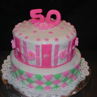 50Th Birthday Cake I made this cake for a teacher at my sons school, she is also an AKA. The bottom layers are Lemon cake/ lemon filling and the top tier is...