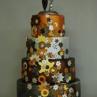 Steampunk Wedding  The design of this cake was inspired by the adorable robot toppers (purchased on-line) The gears are made of gumpaste, cut by a set of...