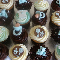 Baby Shower Cupcakes   iced with buttercream and fondant decorations