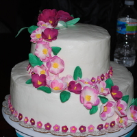 Tropical Flowers My daughter and I made this cake for my brother and his wife's 11th anniversary. This was our first tiered cake. The cake is butter...