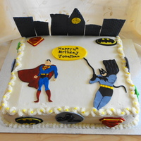 Justice League Cake Vanilla cake with chocolate filling. All decor are made of either gum paste or fondant. I traced the superman and batman on gumpaste and...