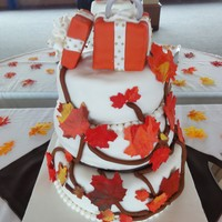 Fall Leaves Engagement Cake I made this cake for my sister's engagement party. 2 tiers coconut cake with pineapple cream filling and 2 tiers are red velvet cake...