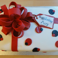 Gift Box Chocolate cake with vanilla mousse filling covered in fondant. All decorations are fondant.