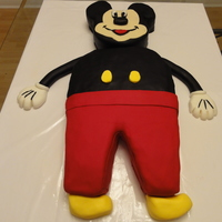 Mickey Mouse Mickey mouse cake made for a very special 1 year old. The head is red velvet cake with chocolate raspberry ganache filling. The body was...
