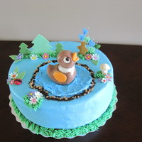 "Duck In Da Pond 9"" vanilla cake filled and iced with vanilla BC chocolate and fondant accents"