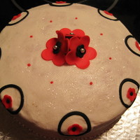 Black&red sponge cake covered with vanilla BC, fondant accent