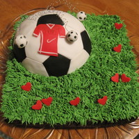 Soccer Field made this cake for my 9 years old son who loves soccer,the hearts scattered over the field represent his age
