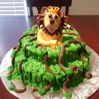 King Of The Jungle This cake was made for my son's first birthday as his smash cake. I made regular cupcakes to go around it for the guest. The lion &amp...