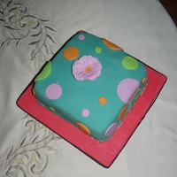 Polka Dots A fun cake with polka dots and a simple flower
