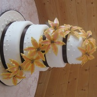 Lily Wedding Cake This is my third wedding cake I have done. The lilies are wired gumpaste flowers that are dusted and dotted with edible marker. The bottom...