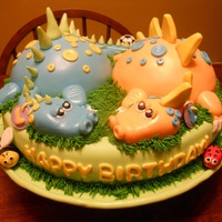 Twin Dragons :) This is a cake for a couple of darling little twin boys. Their family loves soccer- that's why there's a ball in one of the tails...