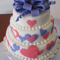 Sweet Sixteen (1St Tier Cake) Pound cake with white fondant covered with pink and purple fondant hearts