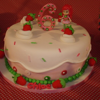Strawberry Shortcake Cake My version and interpretation of all the wonderful Strawberry Shortcake cakes I have seen on here. For my daughters 6th birthday.. This was...