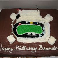 Img_0481.jpg 1st racecar cake. I know it needs some work, you will not hurt my feelings if you post any tips on how to fix it.