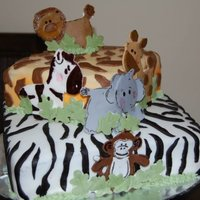Safari Cake Cake inspired by SlimKim but not nearly as well done. Her cake is amazing! Zebra cake is chocolate with strawberry mousse filling, Giraffe...