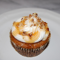 Carrot Cupcakes Carrot Cupcakes with cream cheese icing drizzled with caramel and pecans.