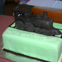 Train 9x13 chocolate cake filled with vanilla butter cream, stacked 3 high. The train is also made of chocolate cake and vanilla butter cream. I...