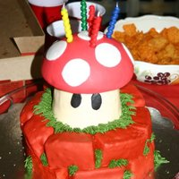 Super Mario Birthday Party This cake was for my Godson's 5th birthday. The top part of Toadstool is made using 1/2 of the 3d cake ball pan - made of yellow cake...