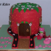 Strawberry Shortcake's House  Cake was done for a 3 year old that loves Strawberry Shortcake. Her mother requested a toy be used rather than a fondant figure so the...