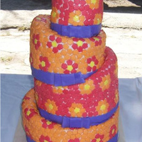 Hippie Topsy-Turvy Wedding Cake  Cake was made for ex-hippies. She wanted a topsy-turvy with bright colors and lots of flowers so she got it and loved it! There are over...