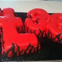 """lil 38"" Flame Cake The cake is shaped to say ""LiL 38, with the L's overlapping to form an i. Covered in red fondant with fondant flames. Disco dust..."