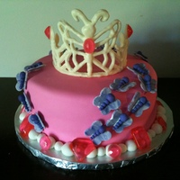 Pink And Purple Butterfly Princess Cake Done for a 2 year old's birthday, who loves pink, purple, butterflies, and was having a princess party. Cake is covered in fondant,...