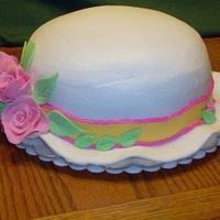 Derby Hat Birthday Cake Butter cream icing with sugarpaste roses.