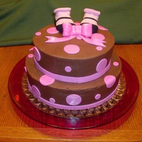Baby Shower Chocolate cake, Chocolate butter cream with Raspberry filling. MMF dots and bow - booties are real baby booties supplied by the grandma to...