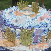 Ocean Underwater Cake For my 4th grade son's end of year party. Vanilla cake with whip cream and strawberries center, buttercream frosting. Shells, fish and...