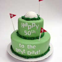 Golf Cake   Golf ball and flags done in fondant. All letters cut with my Cricut Create.