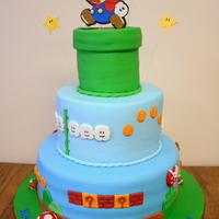 Super Mario Birthday Cake Made this for my hubby's 30th birthday. Everything on the cake is fondant and the Mario/Stars on top are gum paste. Thanks for looking...