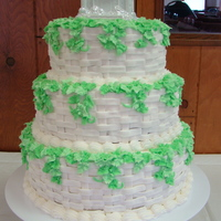 Basket Weave Wedding Cake Three tiered wedding cake with butter cream icing in basket weave design. Two shades of green butter cream to form ivy.