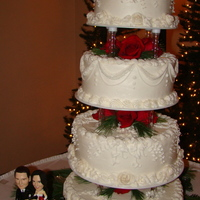 Buttercream Wedding Cake This was for a Christmas silver and red wedding. White and Chocolate cake on four tiered cake stand accented with red Charlotte roses and...