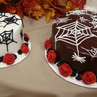 "Halloween Wedding Cake A 6"" round marble cake with butter cream icing and royal icing for black webs and red roses. A 10"" round marble cake with..."