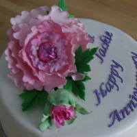 Anniversay Cake  This cake is for my daughter and son-in-law's 3rd wedding anniversay. First time I've made a Peony and also first time I used my...